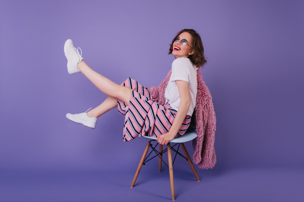 blissful-young-lady-sunglasses-fooling-around-during-photoshoot-chair-laughing-winsome-girl-white-shoes_197531-5165